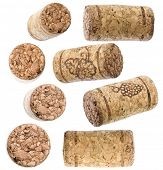 collection of wine corks over white background