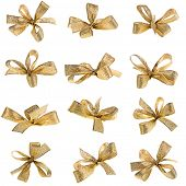 stock photo of ribbon bow  - gift golden ribbon bow isolated on white - JPG