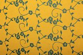 yellow handmade art paper with blue floral pattern