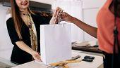 Woman Entrepreneurs At Work In Their Fashion Studio poster