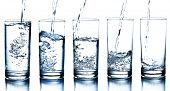 image of drinking water  - five water glasses being filled in descending order - JPG