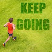 Running fitness inspiration motivation message written on grass texture. Man runner with text KEEP  poster