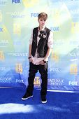 LOS ANGELES - AUG 7: Justin Bieber arrives at the 2011 Teen Choice Awards held at Gibson Amphitheatr