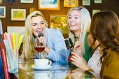 Women Singing Songs In Karaoke Club. Female Friends With Microphone Having Fun. Party, Celebration,  poster