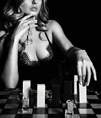 Black And White. Young Curvy Blonde Woman In Lace Nightie With Deep Neckline Playing Chess With Perf poster