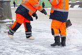 Communal Services Workers Sweep Snow From Road In Winter, Cleaning City Streets And Roads After Snow poster