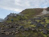 Hiker With Blue Backpack On Laugavegur Trek In Colorful Rhyolit Rainbow Mountain With Multicolored V poster