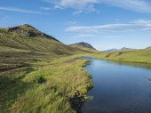 Beautiful Green Hills, Lush Grass And Blue River Next To Camping Site On Alftavatn Lake. Summer Sunn poster