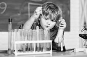 Boy Test Tubes Colorful Liquids Chemistry School Classroom. Kid Study Chemistry. Biotechnology And P poster