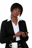Businesswoman tapping a cellphone