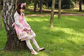 sad japanese woman in sweet lolita cosplay, Tokyo