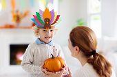 Child On Thanksgiving. Kid With Autumn Turkey Hat. poster