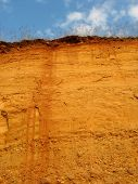 image of loamy  - clay hill scenery after erosion and excavation - JPG