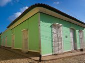 Beautiful old house in the colonial town of Trinidad in Cuba, a famous touristic landmark on the caribbean island poster