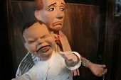 stock photo of spanking  - penny arcade puppets  parent and child - JPG