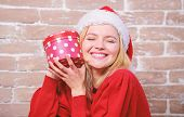 Woman Excited Opening Gift From Santa Claus. Christmas Eve Excitement. Open Christmas Box. Girl Emot poster