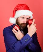 Naughty Is New Nice. Man With Beard Hold Red Balls Christmas Decorations. Winter Holidays. Share Chr poster
