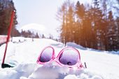 Colorfull Of Pink Sunglasses Placed On Snow At Sport In Ski Resort  Valley With Pine, Landscape Of W poster