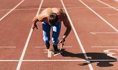 Sprinter Man Preparing For Running On Racetrack At Stadium. Sportsman, Male Runner Sprinting During  poster