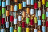Multicolored Thread Bobbin Background, Sewing Threads As A Multicolored Background poster