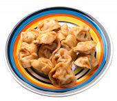 Dumplings On A Multicolored Plate Isolated On White Background. Dumplings In Tomato Sauce. Dumplings poster