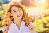 Smiling Redhead Autumn Girl Portrait. Autumn Outdoor Portrait Of Beautiful Happy Girl Walking In Par poster