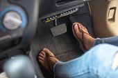 Woman Foot Driving Car With Shoe Pushing On Car Speed Pedal. Female Feet With Brake And Accelerator  poster