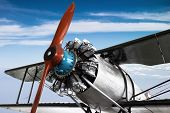 Vintage Propeller Airplane With Cloud And Blue Sky Background. poster
