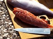 stock photo of redfish  - Redfish and dentex on wooden board at beach - JPG
