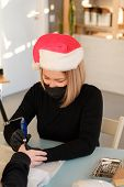 Manicurist In Christmas Hat Makes A Hardware Manicure. Finger Treatment Of Nails. Electric Nail File poster
