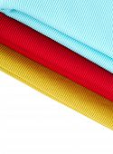 Colorful Fabric Swatches On Shopfront. A Lot Of Fabric Rolls. Textile Samples Background. Jaws Of Co poster