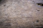 Grey Wooden Texture Photo. Timber Board With Weathered Crack Flat Lay. Rustic Wooden Table Top View. poster