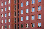 Facade Of Office Building With Windows. Facade Of An Old Red Brick Wall With Windows. Old Red Brick  poster