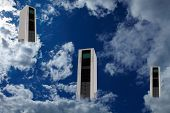 Three computer server in clouds as cloud computing concept