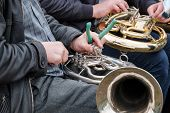 A Street Musician Repairs A Broken Musical Instrument On The Spot. Street Musicians Are Forced To Re poster
