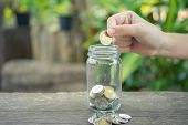 Businessmen Put The Coin In A Glass Jar To Save Money, Save Money On Investments, Spend Money When N poster