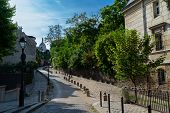 View Of Historical Street In Quarter Montmartre In Paris, France. Cozy Cityscape Of Paris With Sacre poster