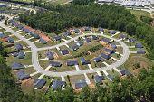 Aerial of suburban neighborhood culdesac homes in the eastern United States.