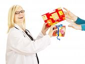 pic of lobbyist  - A female medical doctor grabbing two gifts - JPG