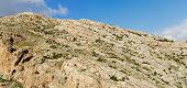 picture of jericho  - Texture of a layered sedimentary rock under the blue sky - JPG