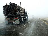 stock photo of snow-slide  - Semi truck driving down highway during blizzard snow storm - JPG
