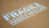 foto of fragile sign  - Fragile Handle With Care Sign On A Package