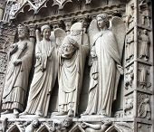 St. Denis Decapitated seen at the left hand side of the main entrance to Notre Dame Cathedral