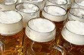 pic of bavaria  - Beer jugs on wooden desk - JPG