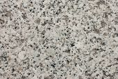 picture of granite  - A smooth surface of granite with various speckles for background image - JPG
