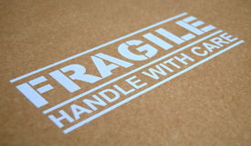 stock photo of fragile sign  - Fragile Handle With Care Sign On A Package