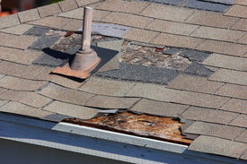 pic of shingles  - A close up view of shingles being blown off a roof and other roof damage - JPG