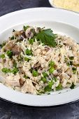 Mushroom, pea and chicken risotto with parmesan cheese.