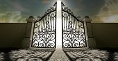 image of entryway  - A set of ornate gates to heaven opening under an ethereal light and cloudy afterlife - JPG