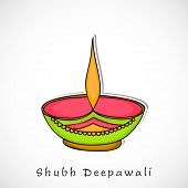Indian festival of lights, (Shubh Deepawali) Happy Deepawali background with illuminated colorful oil lit lamp on grey background.